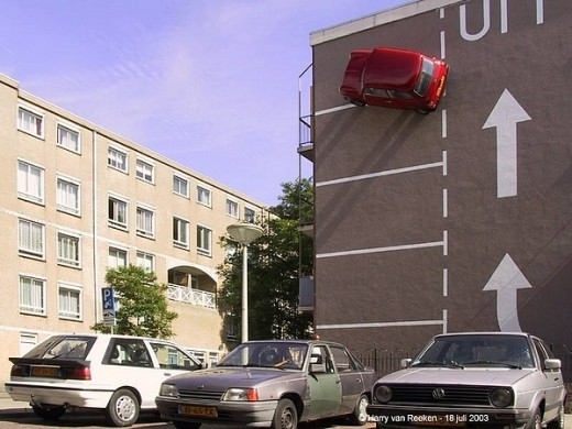 Car parked on a wall