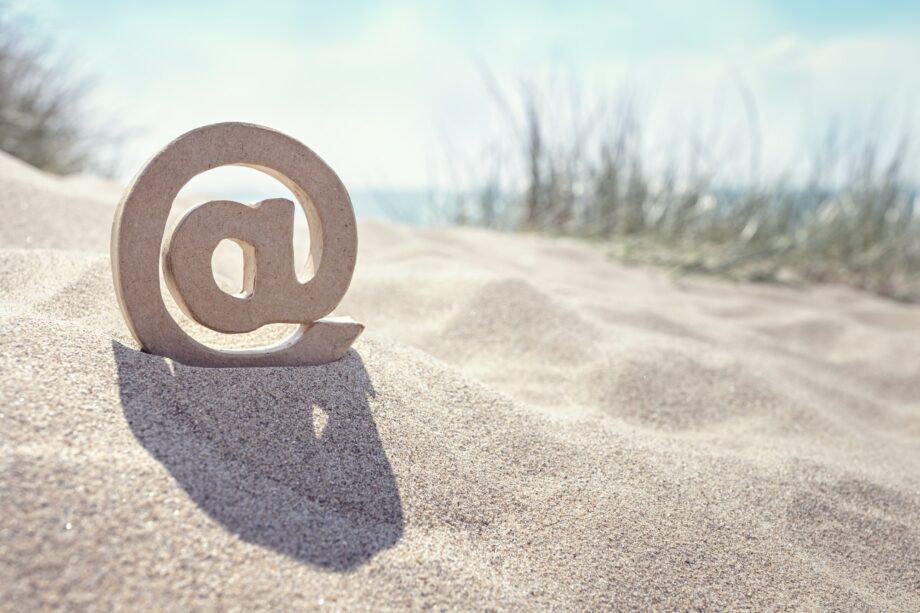 E-mail @ symbol at the beach
